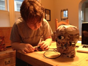 Henry builds the papercraft Chrome Skull for his school science project
